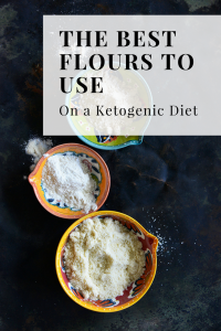 the best flours to use on a ketogenic diet. Flour in color bowls with a black background.