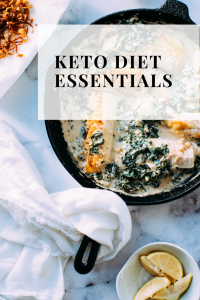 cast iron skillet filled with keto fish and spinach recipe