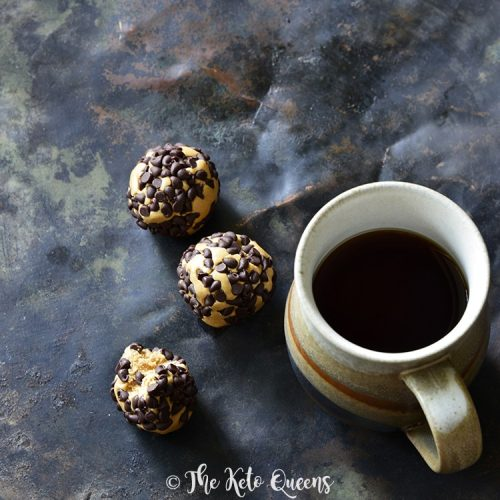 3 chocolate peanut butter protein bites with a cup of coffee