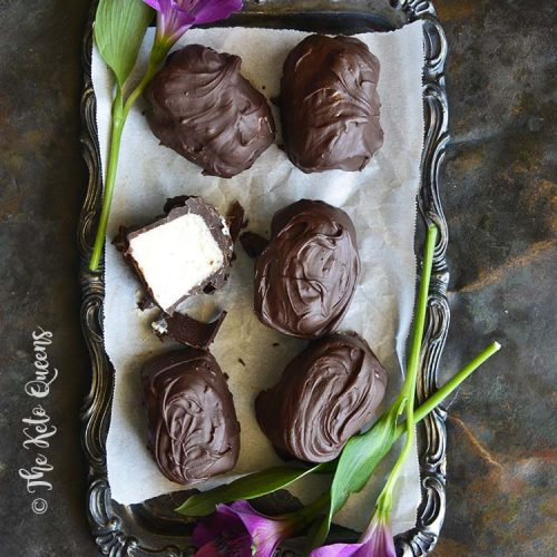 Low Carb Chocolate Covered Vanilla Buttercream Truffle Candy (Keto Fat Bombs) on Vintage Tray