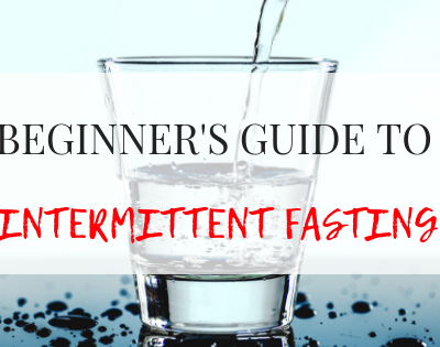 BEGINNER'S GUIDE TO INTERMITTENT FASTING text on a glass of water