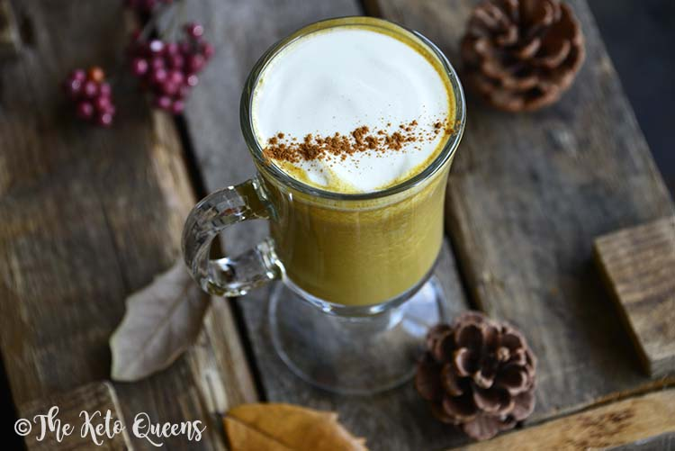 Low Carb Sugar Free Pumpkin Spice Latte with Autumnal Leaves and Pinecones