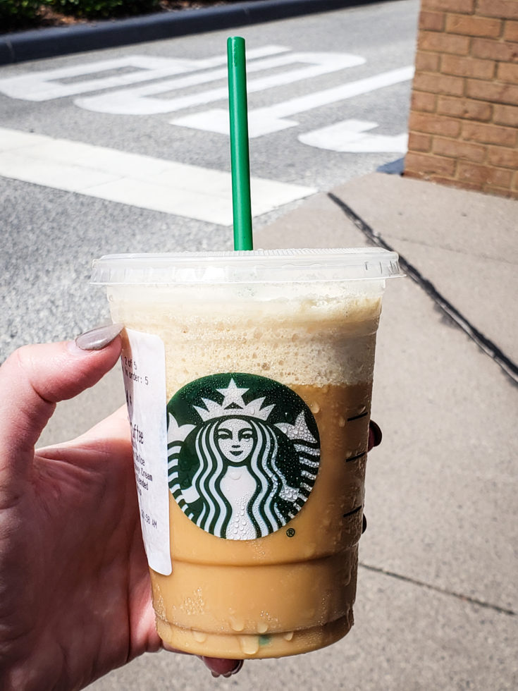 image of a person holding a keto frappuccino