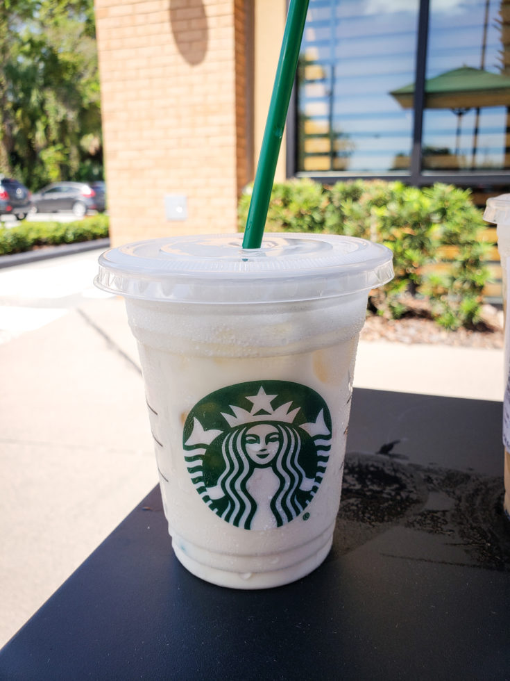 picture of a keto white drink on a table outside of starbucks