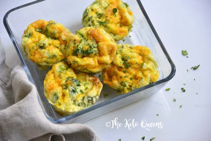 horizontal image of broccoli and cheddar egg muffins in a glass storage container with a napkin