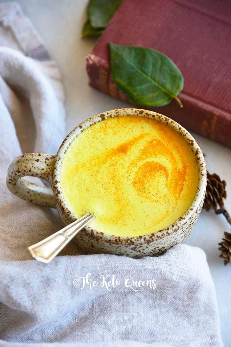 Golden Milk with Swirl of Turmeric on Foamy Top