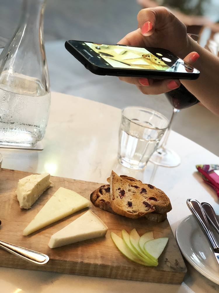 Taking Mobile Phone Picture of Cheese Board