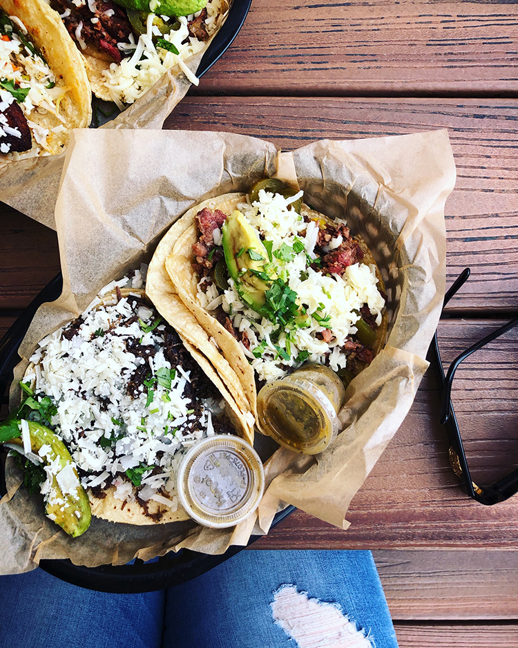 Overhead Shot of Torchy's Tacos on Wooden Table with Sunglasses