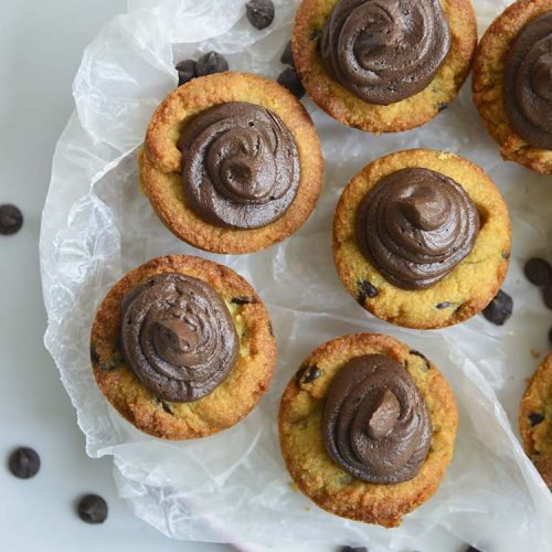 These Chocolate Chip Cookie Cups are so rich and chewy, you'd never know they were low carb, gluten free and keto friendly! Filled with low carb chocolate buttercream these easy to make cookie cups will impress any guest!