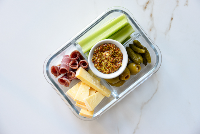 Charcuterie and cheese is a quick and easy keto meal prep idea! Pack some charcuterie meats, cheese, pickles, olives, and celery in your favorite meal prep container. It'll make for a delicious, grab and grow lunch.