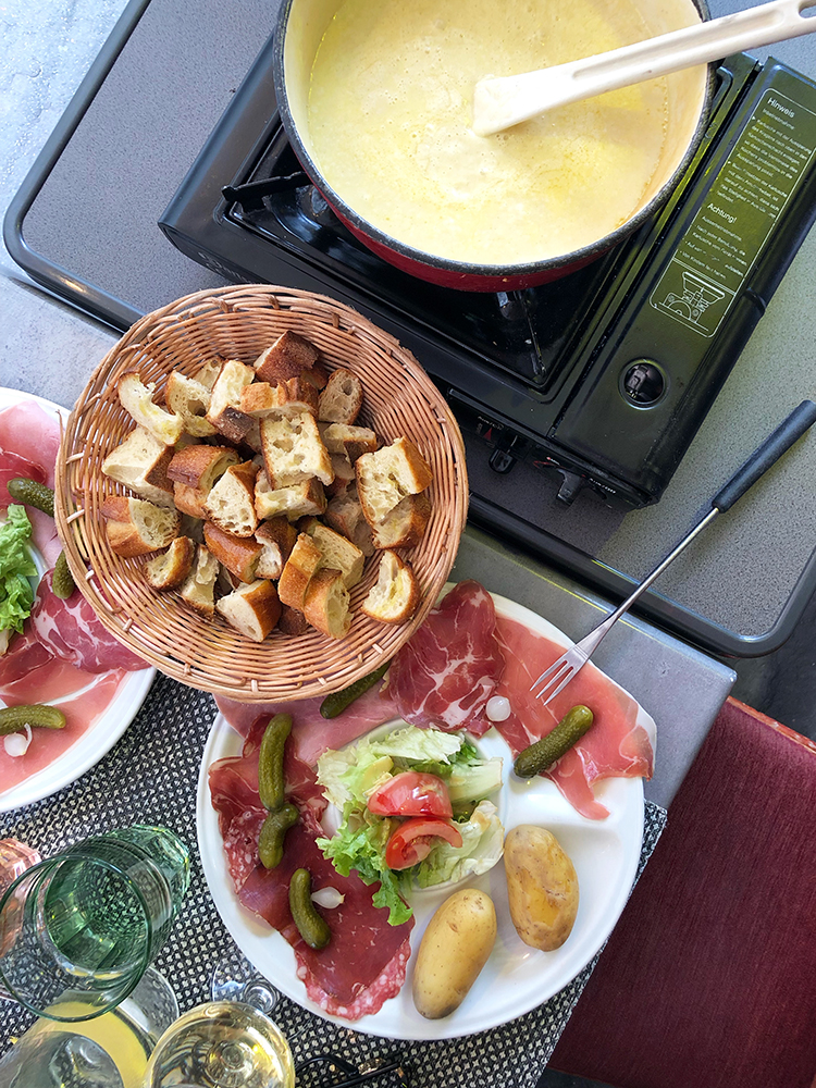 Fondue Spread with Charcuterie, Vegetables, and Bread Cubes