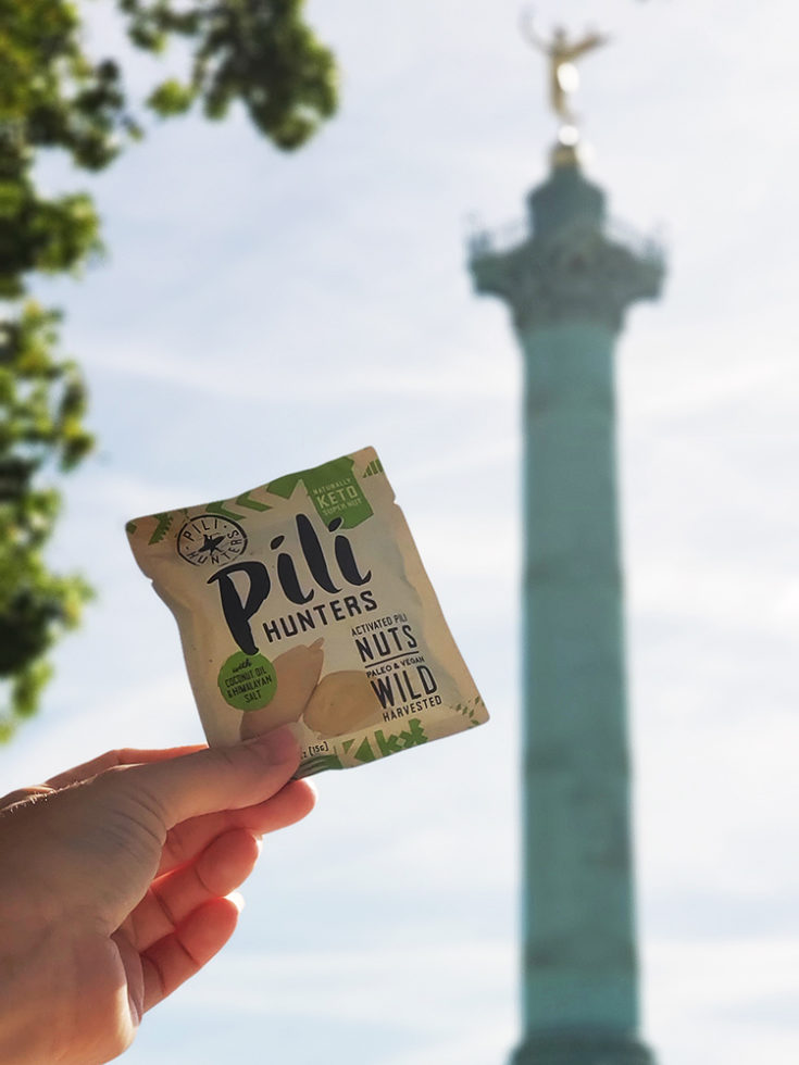 Pili hunters a keto travel snack in from of Bastille in Paris