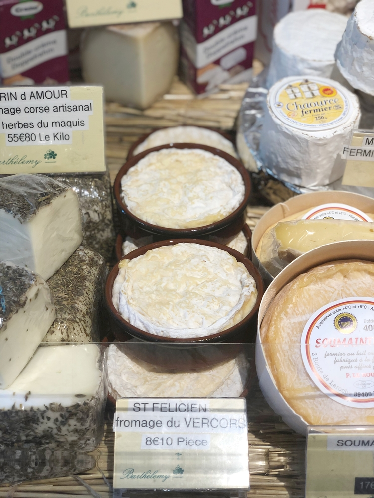 Saint Felicien Cheese on Shelf in Paris Cheese Shop