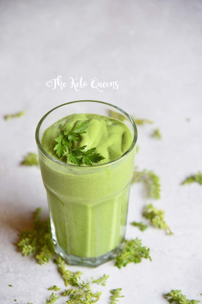detox keto green smoothie in a clear cup with parsley on top
