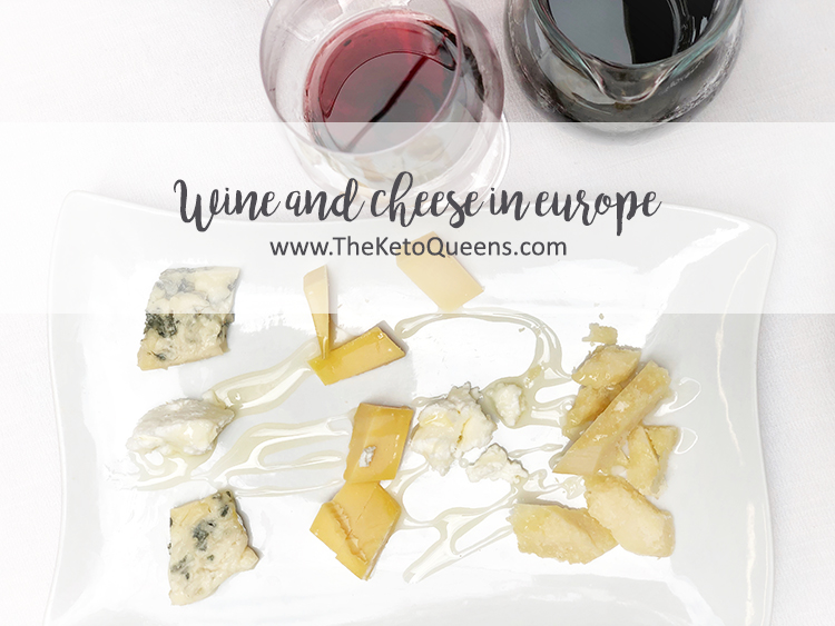 Wine and Cheese in Europe with a Selection of Cheese on a White Tray Next to a Glass of Red Wine