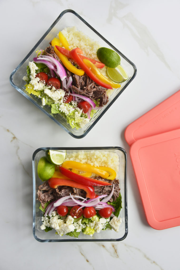 2 prepared keto chipotle bowls in square glass meal prep containers with lids