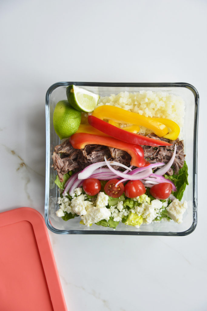 Prepared keto chipotle bowls in square glass meal prep containers with lid