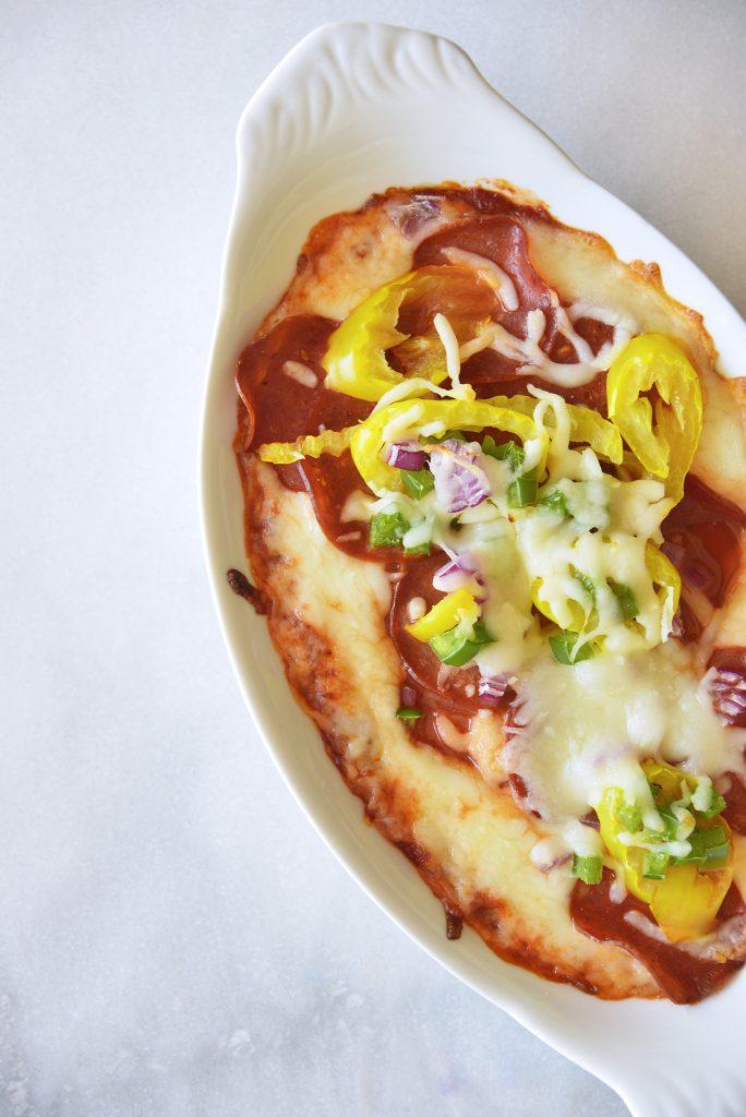 Easy Keto Pepperoni Pizza Dip Recipe in a white casserole dish