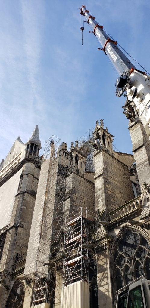 notre dame being rebuilt after fire damage