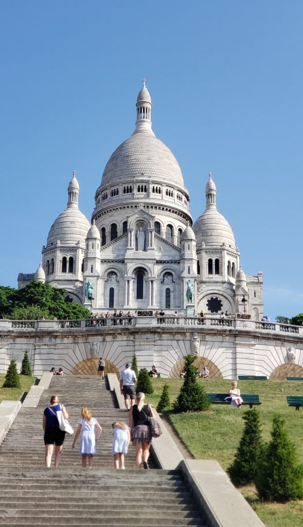 view of sacre coeur from the bottom of the step
