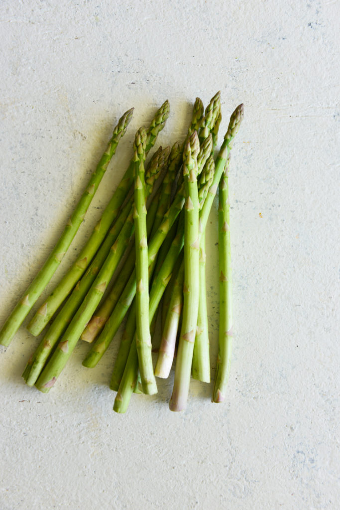 image of asparagus on a white surface