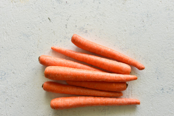 image of carrots on a white surface