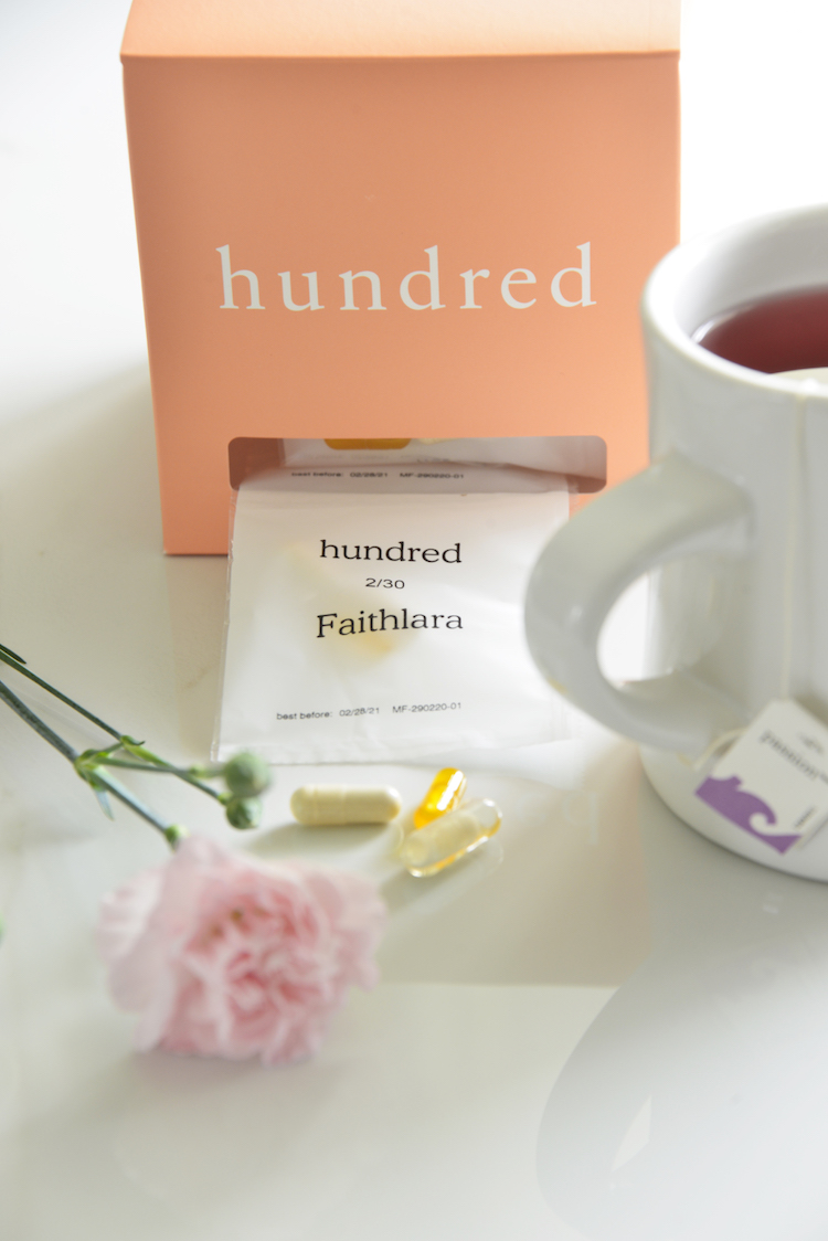 image of hundred vitamins with carnations and a cup of tea