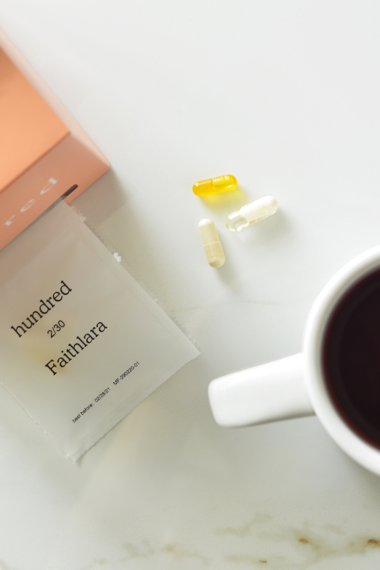 image of hundred vitamins with a cup of tea